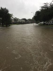 Flooded Houston residential street can be seen after Hurricane Harvey hit Texas. You may be able to claim a casualty loss tax deduction for the damages you suffered.